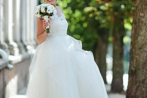 Young beautiful bride posing outdoors