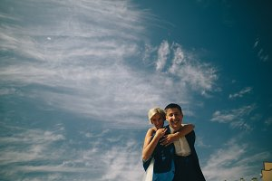 bride and groom  on the background of sky
