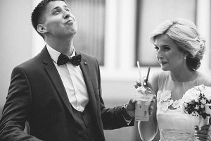 Happy young couple drinking ice coffee