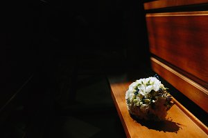 bridal bouquet lying on the bench
