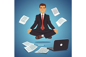 Businessmanmeditating and levitating