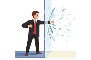 Businessman breaking through wall