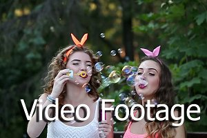 Funny friends inflate soap bubbles