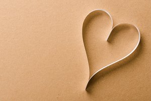 heart on old shabby wooden background.
