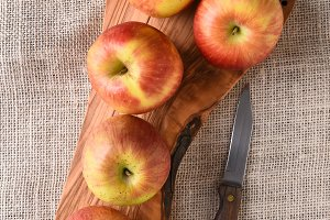 Braeburn Apples on Cutting Board