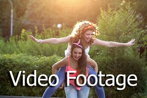 Girl holds friend on piggyback