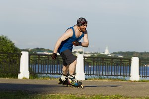 A man riding on roller skates in the city