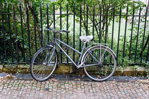 Bicycle parked in a fence