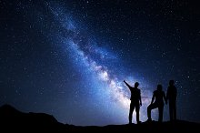 Milky Way. Silhouette of a family