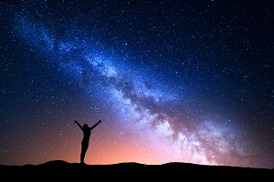 Milky Way and silhouette of a woman