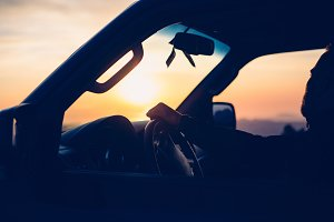 Man in a car backlighting