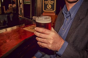 Man drinking beer in London pub