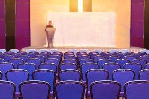 speaker prepares to lecture