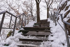 Snowy stairs covered in winter