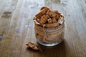 Biscotti cookies in glass jar, wood background