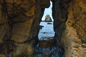 Seascape through slit in rock.