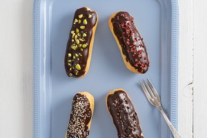 Chocolate eclairs with toppings