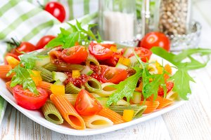 Colorful pasta on white plate