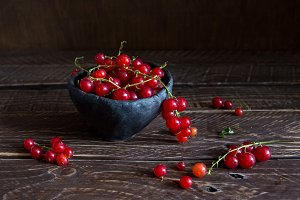 red currants on a brown background