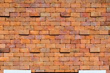 Window on orange brick wall