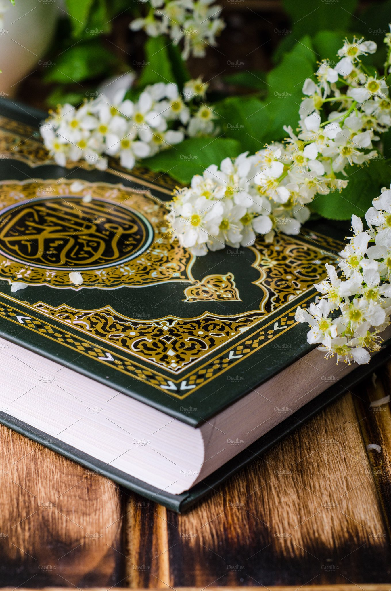 Quran Holly Book Of Islam With Spring Flowers And Blue Scarf On Wooden Background Selective
