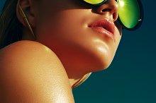 Tanned girl in sun glass.
