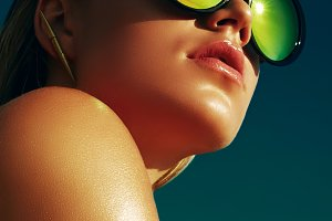 Tanned girl in sun glass.