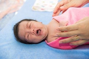 Newborn baby girl crying