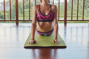 Fitness female doing core stretch