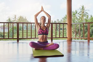 Fit young female doing yoga