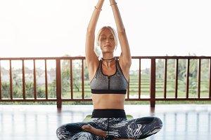 Fitness female model doing yoga