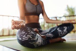 Woman body in yoga pose