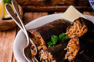 eggplant stuffed with meat and rice in bowl on wooden background. Selective focus. Arabian cuisine