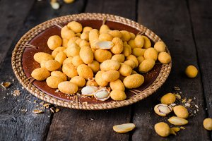 Spicy almonds in salted glaze - arabic delicious snack. Ramadan food. Selective focus. Wooden background