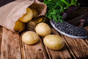Fresh new potatoes on wooden background