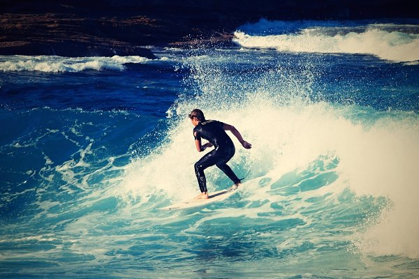 Surfing down the wave