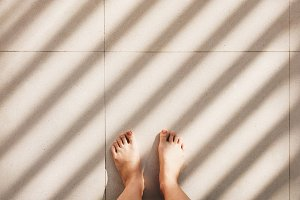 Selfie of feet with light and shadow