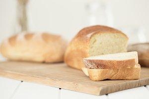 Slices and bun of  fresh white bread