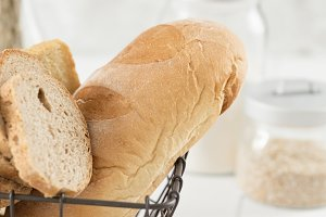 White and wheat bread in basket