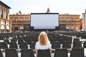 Girl sitting in the summer cinema