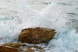 Sea wave covered the rock