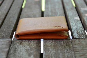 Brown Leather Wallet on wood