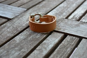 Brown Leather Bracelet on wood