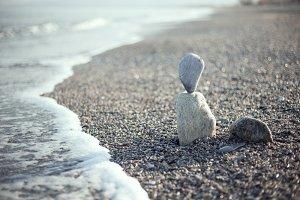 Balance pebbles on the beach