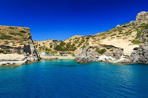beautiful bay and rocks view from sea Rhodes Greece sunny day