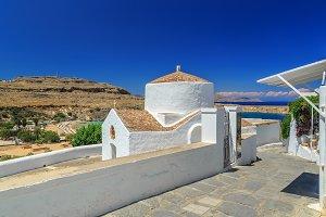 Greece, Rhodes. Sea views, mountains and a large white church. Lindos