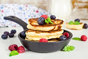 Pancakes or fritters with berries