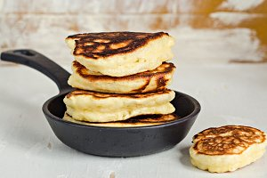 Pancakes or fritters in iron pot