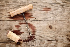 Corkscrew, cork and wine stains