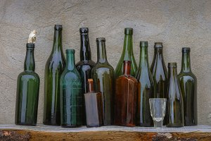Old wine bottles and glass